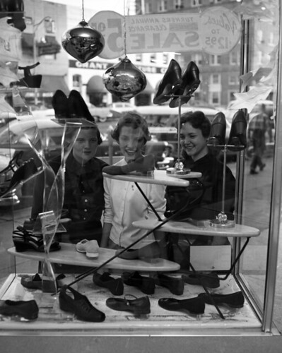 Unidentified young women window shopping at Turner's store in Tallahassee, Florida