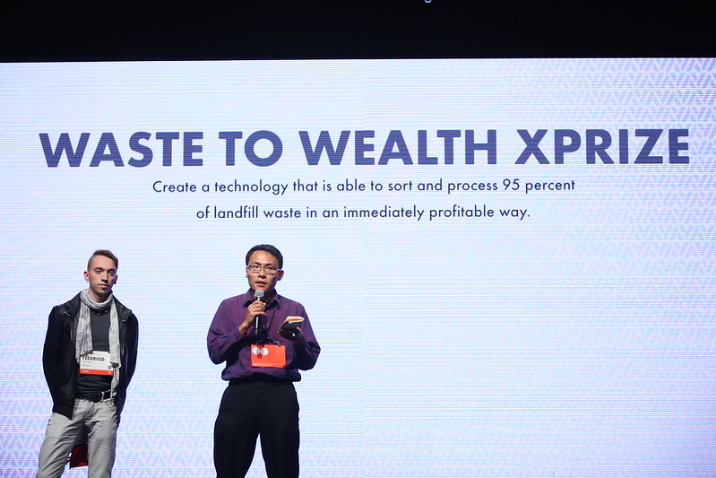 Federico Pistono and Tom Chi presenting at the XPRIZE finals.