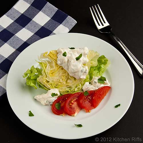 Blue Cheese Dressing on Wedge Salad with Napkin and Fork