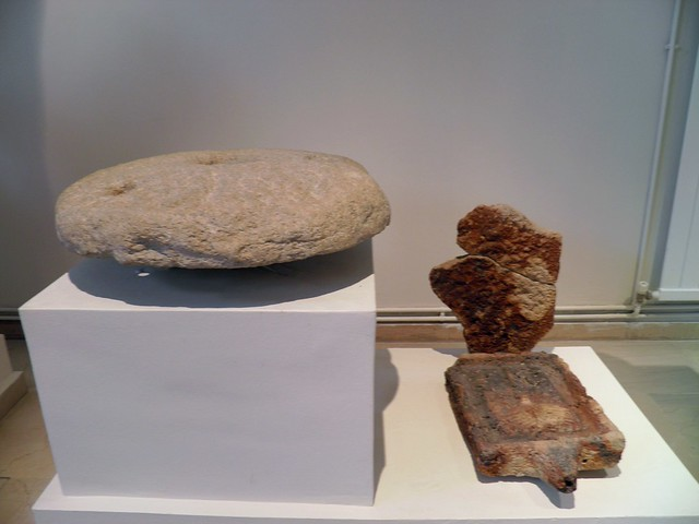 Ritual ustensils: millstone and press-fruit, from the sancturay of Isis, 2nd c. AD, Archaeological Museum, Dion