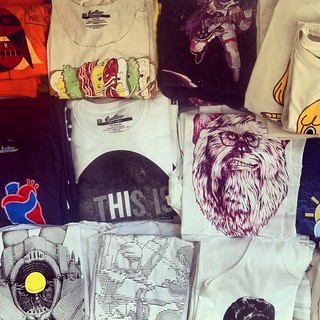 Here's a sneak peek at our to be photographed table filled with soon to be released tees.