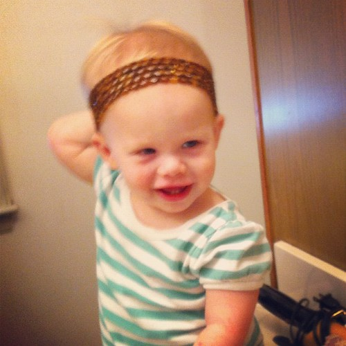 Lucy models Mommy's headband.