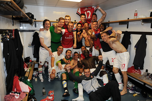 Arsenal players celebrate after the match