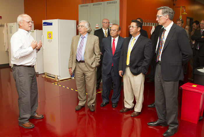 Dick Sayre, left of Los Alamos National Laboratory's Bioscience Division and the New Mexico Consortium, briefs DOE Secretary Ernie Moniz, New Mexico Institute of Mining and Technology President Daniel Lopez, New Mexico Congressman Ben Ray Lujan and Laboratory Director Charlie McMillan Tuesday at the New Mexico Consortium biological laboratory.