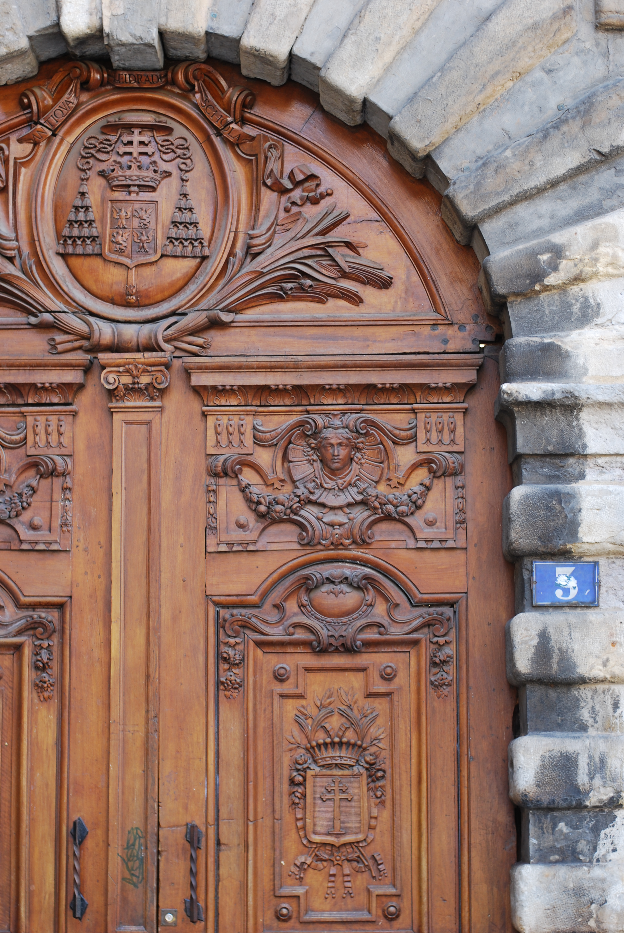 chambray and curls Lyon France Summer Travel old town ornate wooden doors