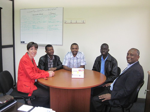 From left is Santie Devilliers from ICRISAT-Nairobi with the three students Dagnachew Lule (Ethiopian), Ismail Mohamed (Tanzanian) and Isaac Dramadri (Ugandan) with Seyoum Leta, Bio-Innovate Program Manager discussing the progress of their training at Bec