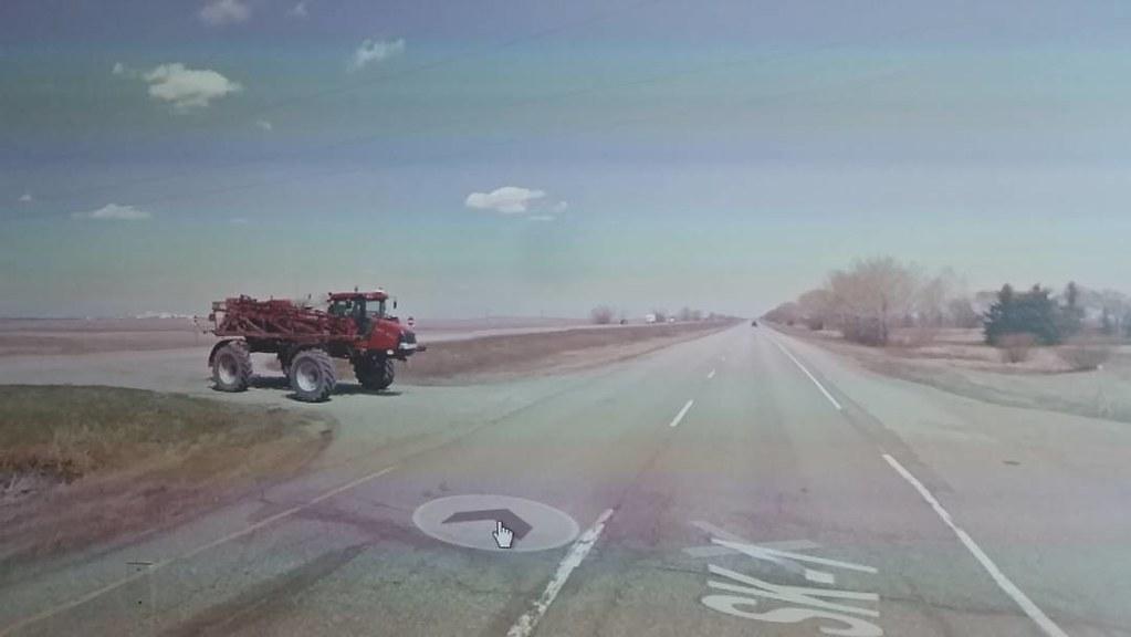 Lovely red high clearance sprayer! #ridingthroughwalls #googlestreetview #xcanadabikeride #Saskatchewan
