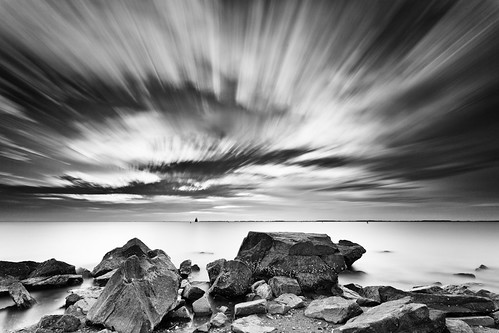 longexposure bw lighthouse seascape beach water clouds sunrise sand shoreline maryland boulders barnacles chesapeakebay acrosstheuniverse sandypointstatepark bigstopper