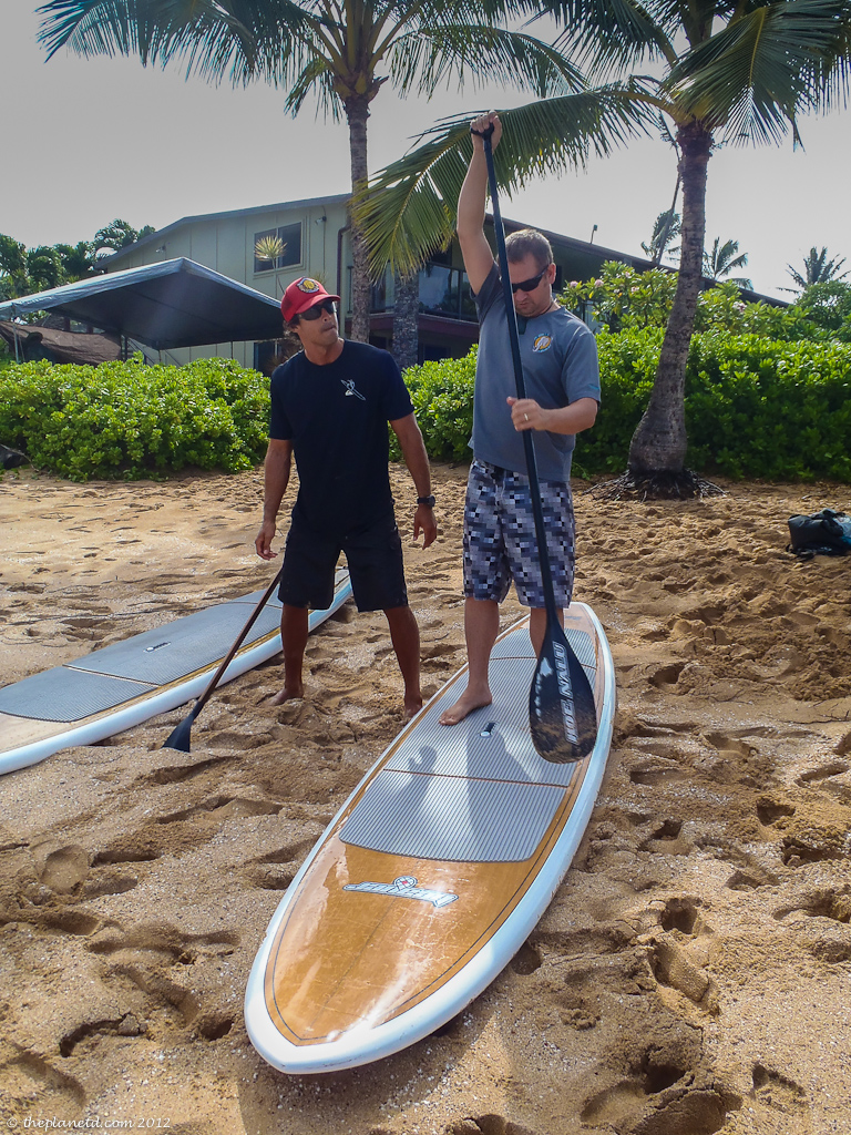 Travel Couple Better Half Dave practices Stand Up Paddle Boarding