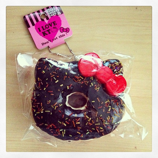 I'm still not quite sure what possessed me to buy this squishy styrofoam chocolate Hello Kitty Donut keychain.  It's the size of a real donut too! Hmm...