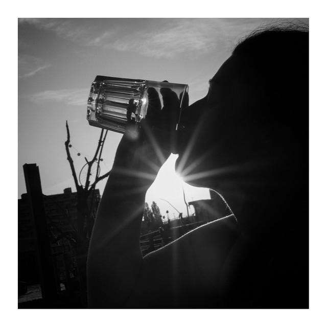 she a glass und sunset