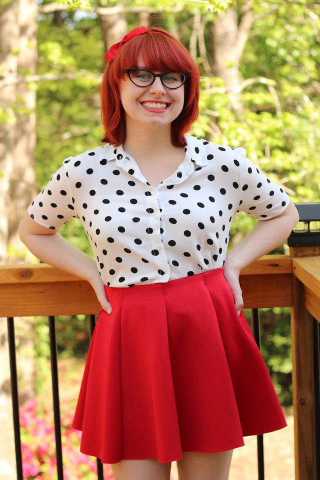 White Polka Dot Blouse, Red Neoprene Pleated Skirt, Cat Eye Glasses