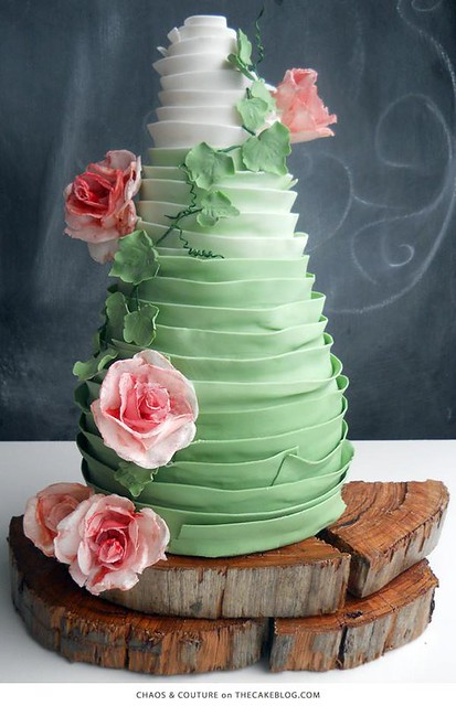 Green ombre ruffles cover this towering beauty by Chaos & Couture - Cakes By Nadia