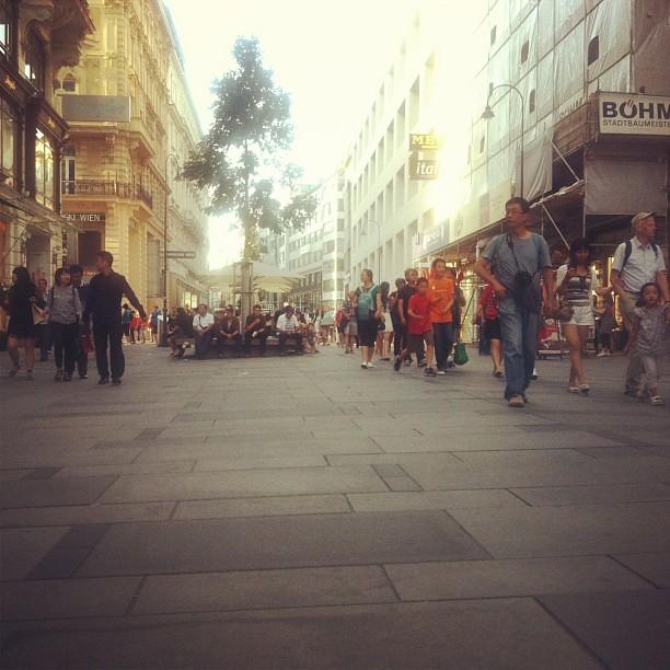People-watching people watching a street performer. ??