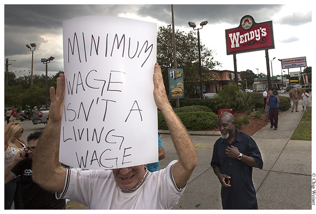 Tom Filbert who is currently unemployed demonstrates for higher wages for fast food workers