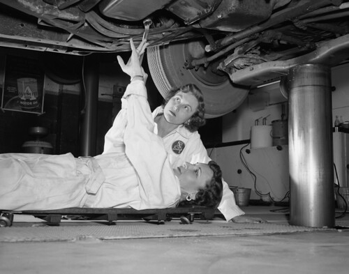 Women taking a course in car care, maintenance, and operation in Tallahassee, Florida