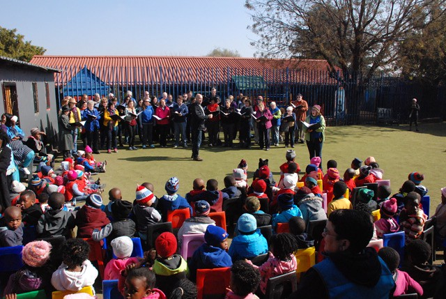 Singing City gives an informal performance at Pam's Creche in Soweto
