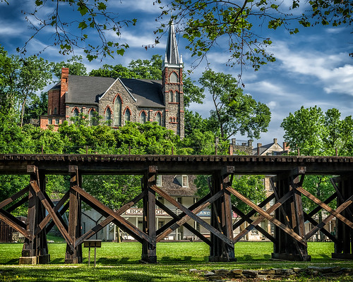 railroad trestle blue trees sky green leaves stone architecture clouds landscape wooden nationalpark catholic pentax gothic westvirginia harpersferry neogothic stpeterschurch fa31 k30 fa31limited pentaxart winchesterandpotomac