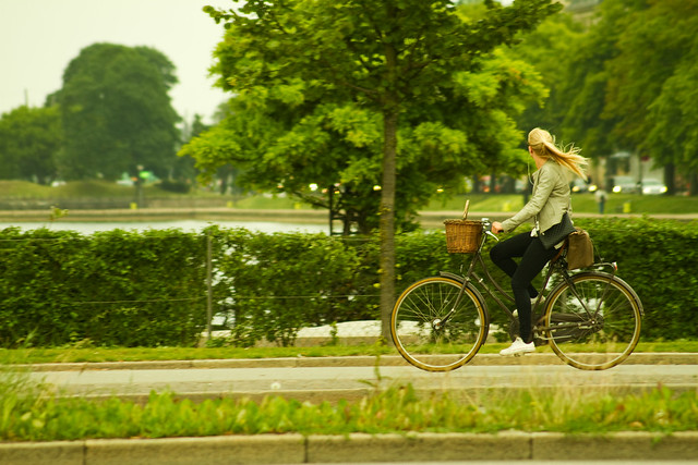 Girl Cycling By the Lakes