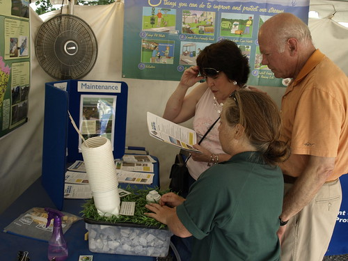 Image of a DEP staff member teaching two residents about stormwater management.