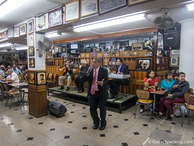 A tango singer performs inside Salon Malaga