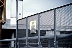Danger! High Voltage sign at the Ada Bridge construction site.