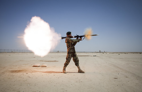 <p>An Afghan National Army soldier assigned to Mobile Strike Force Kandak fires an RPG-7 rocket-propelled grenade launcher May 20, 2013, during a live-fire exercise at Camp Shorabak in Helmand province, Afghanistan. U.S. Marines with a mobile strike force adviseory team supervised the exercise. (DoD photo by Staff Sgt. Ezekiel R. Kitandwe, U.S. Marine Corps/Released)</p>
