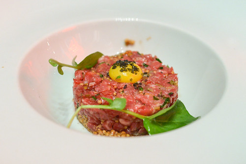 Smoked Beef Tartare lemon zest, red onion, capers, guinness infused mustard seeds, yukon gold herb chips