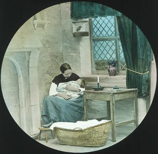 Jane Conquest nursing her sick baby [transparency] : part of a lantern slide lecture collection, 1926 /