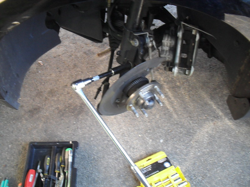 how to get top bolt off of front struts