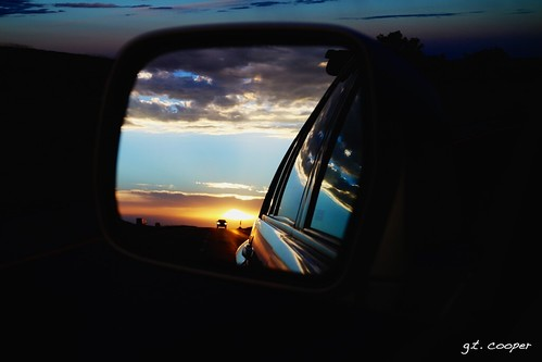 road travel sunset sun reflection car clouds canon mirror moving highway driving steering sundown rear going rearviewmirror explore dos freeway interstate sideviewmirror behind traveling rearview i70 eastbound eosm kuper heretothere mirrorless kuperimages gtkuper