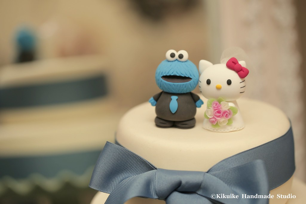 Cookie Monster And Hello Kitty Wedding Cake Topper