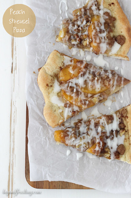 This Peach Streusel Pizza is a cinnamon and sugar-loaded pizza dough covered in peaches, walnuts and a vanilla glaze.