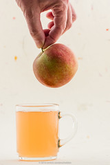 Apple juice and floating apple.