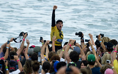 Mick Fanning is carried up the beach after defeating Kelly Slater in the Final in front of a standing-room-only crowd