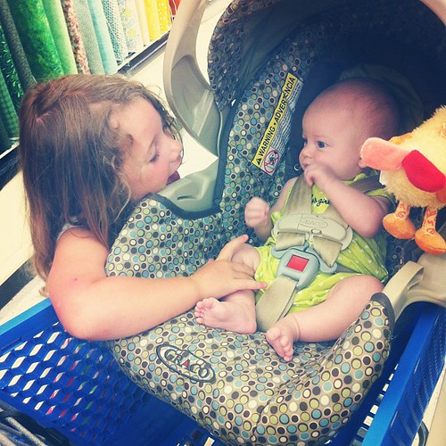 Cousin love in the fabric store.