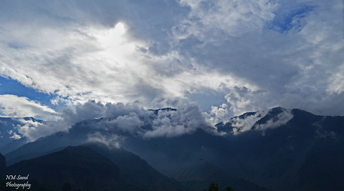 pakistan light sun mountain mountains clouds sunrise landscape lights daylight rays chitral