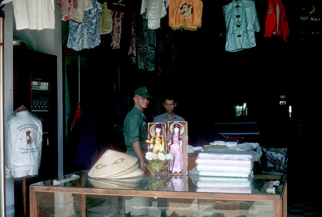 Vietnam 1965 - Photo by Ted Yates - Lt. John Coggin shopping in An Khe