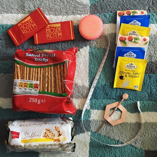 My #Knitmas elf sent me tea, pretzel twigs, chilli chocolate, stollen, a coppery shawl pin, and a Makery measuring tape. Such treats!!!