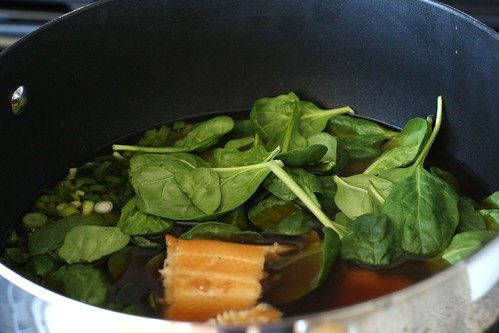 Steep the broth, spinach, trout, and onions