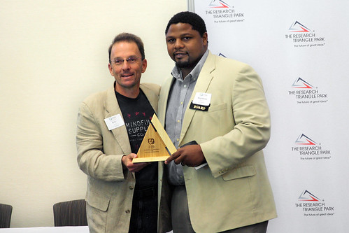 Eric Henry receives his award from Napoleon Wallace with Self-Help.