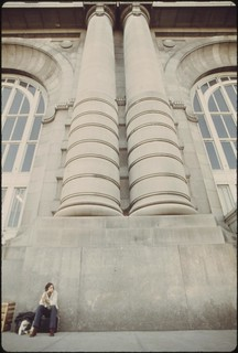 Columns in front of the Union Station in Kansas City Missouri, give an idea of the massiveness of the terminal and acts as a back rest for a traveler, June 1974