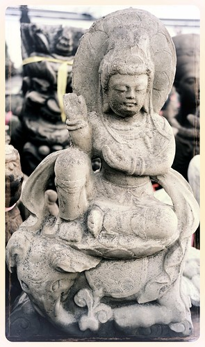Manjushri riding an elephant, open hand, seated on a lotus, robes, jewels, head dress, splashing water, concrete statue, Dario's Shop, Lake City Way, Seattle, Washington, USA by Wonderlane