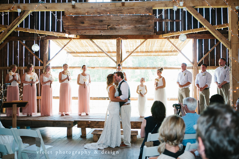 bride & groom kiss in the barn
