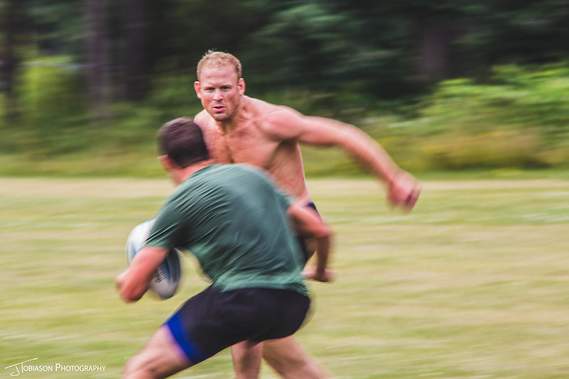 Groom playing rugby