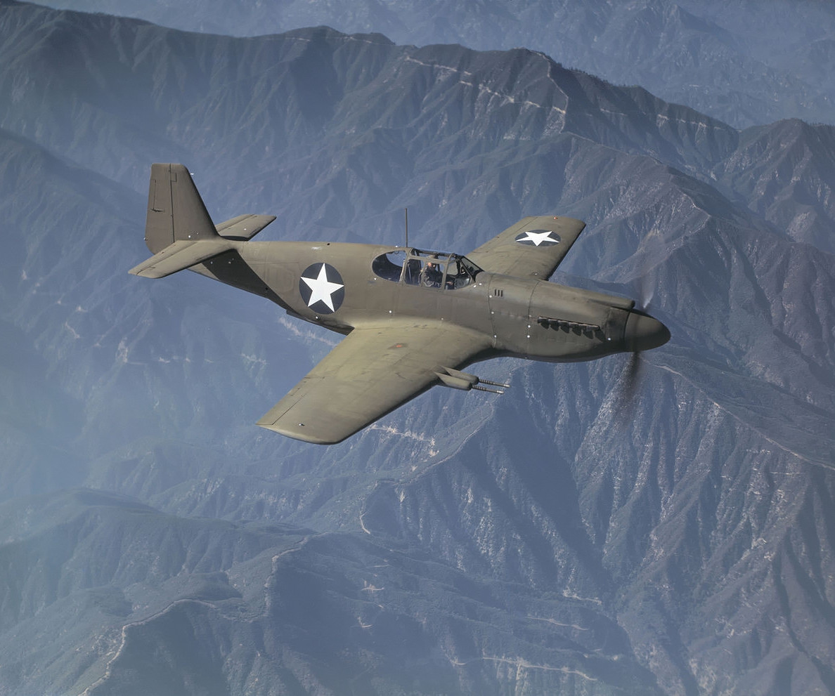 A North American Mustang Mk. IA on a test flight from NAA's Inglewood, California facility in October 1942. The painted-over serial number appears to be 41-37416. According to Warbird-Central.com it was damaged during shipment to Europe in late 1943.