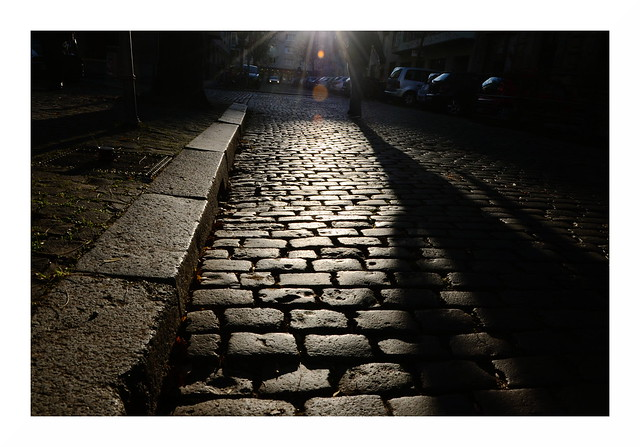 curb, cobbles and a walking giant