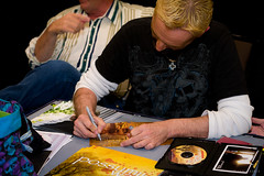 Parrish Randall signs a DVD jacket for a fan.