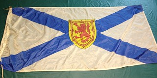 "Novia Scotia Flag - 27""x54"" - printed nylon, Rope and toggle finish."