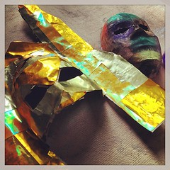 Zach's masks. This gold is perfect. #arted @acsrochester #masks
